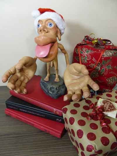 Photograph of a Sensory Homunculus, surrounded by christmas presents
