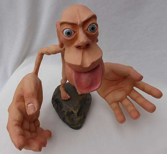 Picure of the Front of a Sensory Homunculus by Sharon Price-James photographed aginst black background