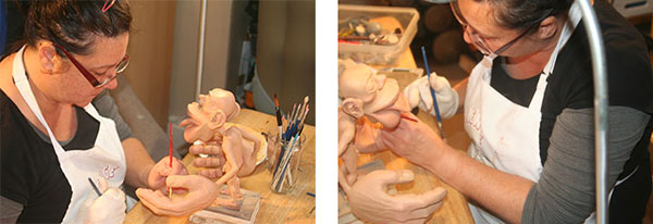 Picture of the artist Sharon Price-james painting the hands of a Sensory Homunculus